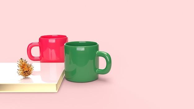 Décoration de noël avec un couple de tasse à café en céramique, livre et pomme de pin.