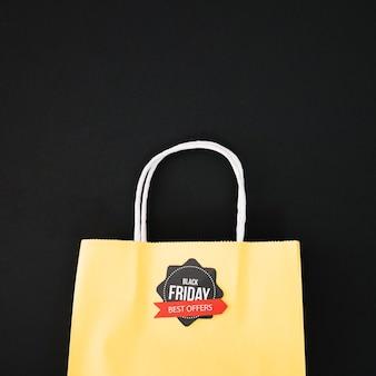 Décoration pour vendredi noir avec sac jaune