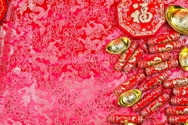 Décorations du festival du nouvel an chinois, paquet de pow ou rouge et lingots d'or.