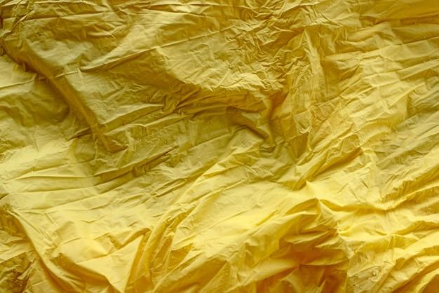 Défocalisation textile abstrait riche jaune vif froissé
