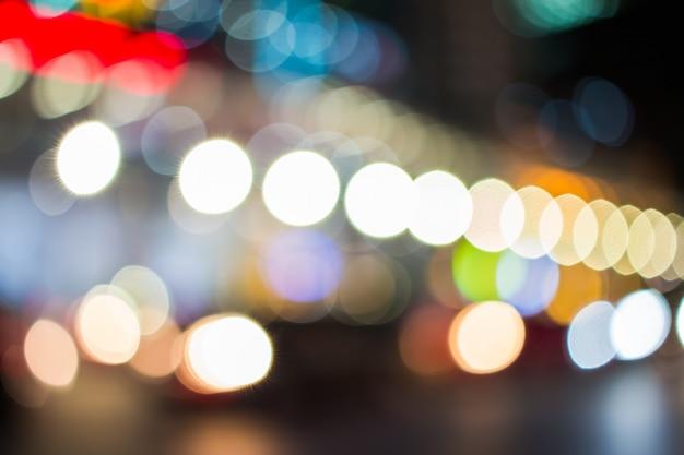 Defocused christmas orange jaune bokeh couleur blanche lumières flou fond de ville en lumière de nuit