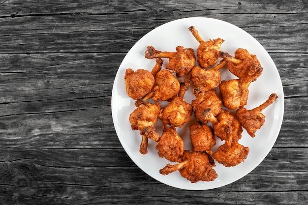 Délicieuses ailes de poulet croustillantes et frites