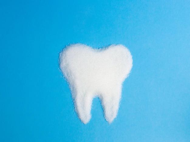 Dent de sucre sur bleu, symbole