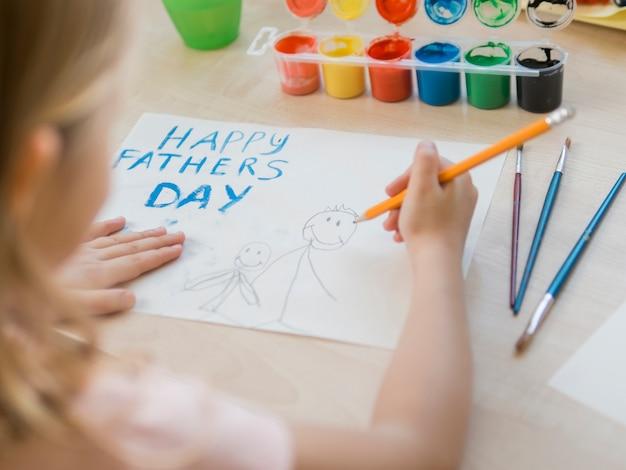 Dessin de fête des pères heureux fait par la fille