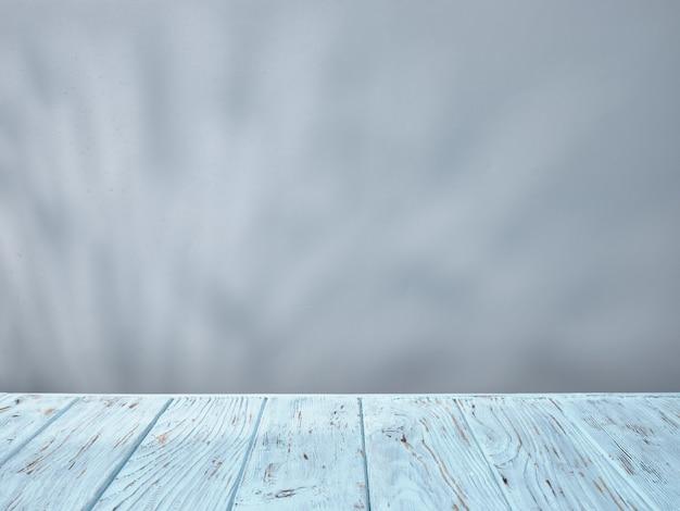 Dessus de table bleu avec rayon naturel et ombres de lumière sur fond