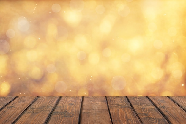 Dessus de table en bois sur fond abstrait doré bokeh