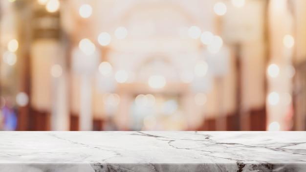 Dessus de table en marbre blanc et fond abstrait flou