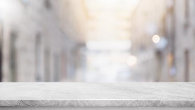 Dessus de table en marbre blanc pierre vide et fond abstrait flou du centre commercial en arrière