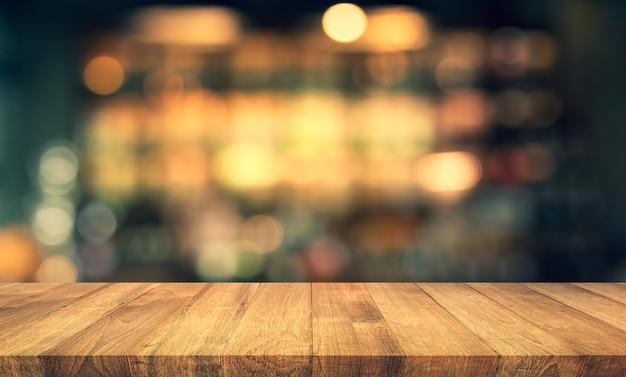 Dessus de table de texture bois avec flou bokeh or clair au café, restaurant