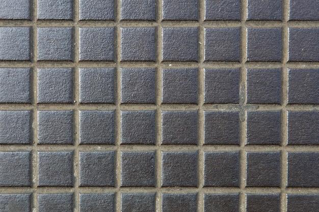 Détail de l'ancien motif de fond carré en métal