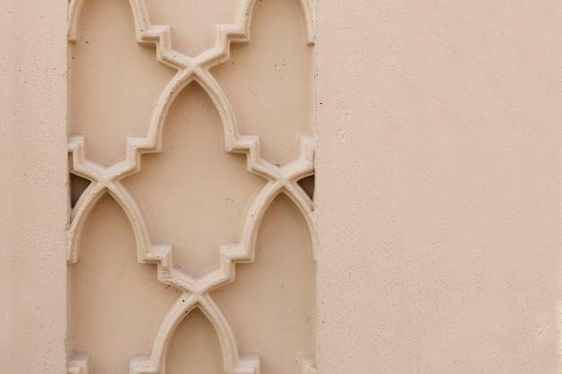 Détail d'un motif oriental sur un mur avec espace de copie. fond, texture