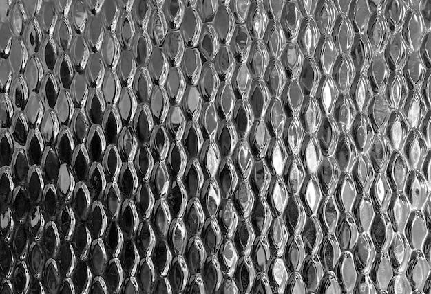 Détail d'un mur carrelé avec une surface en miroir. style métallique. fond, texture
