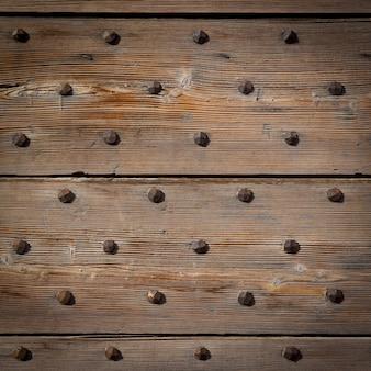 Détail d'une porte italienne de 200 ans, en bois. utilisation en arrière-plan.