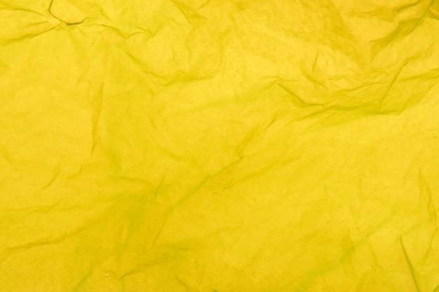Détail de la texture d'un sac en plastique jaune