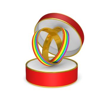 Deux anneaux lgbt dans une boîte cadeau sur blanc