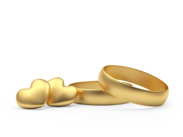 Deux anneaux de mariage avec des coeurs en or