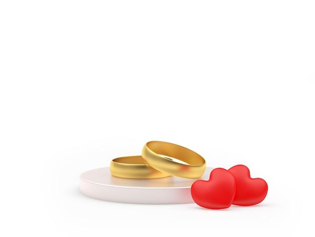 Deux anneaux de mariage en or et coeurs sur un support
