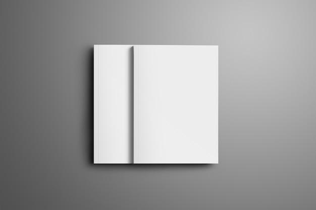 Deux brochures a4, (a5) fermées vierges avec des ombres douces et réalistes isolées sur une surface grise. l'une des brochures se trouve au-dessus de la deuxième brochure.