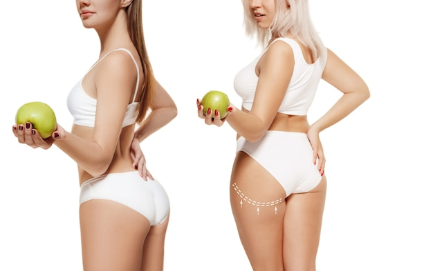 Deux jeunes femmes épaisses et minces ont des chiffres différents concept de comparaison