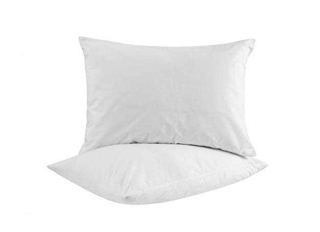 Deux oreillers blancs isolés sur fond blanc. vue de côté.