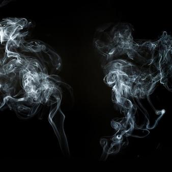 Deux Silhouettes De Fumée Abstraites Photo gratuit