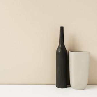 Deux vases élégants sur neutre pastel. concept de design de décoration intérieure moderne.