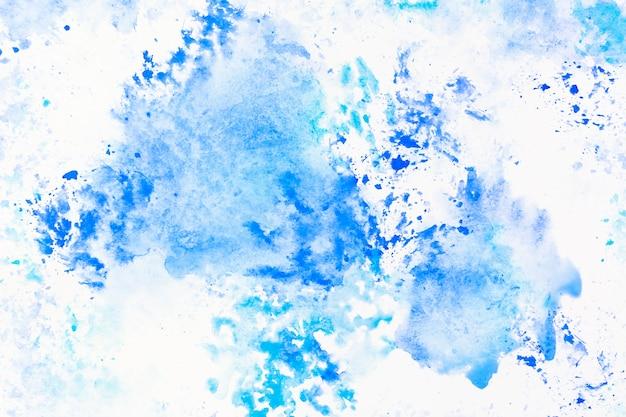 Déversements d'aquarelle bleue