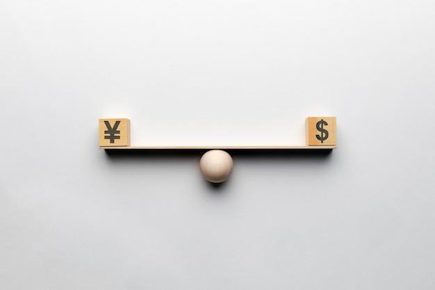 La Devise Dollar Est égale Au Yen Sur La Balance. Photo Premium
