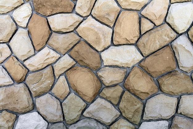 Différentes tailles de pierres de sable. impression de fond mur de pierre