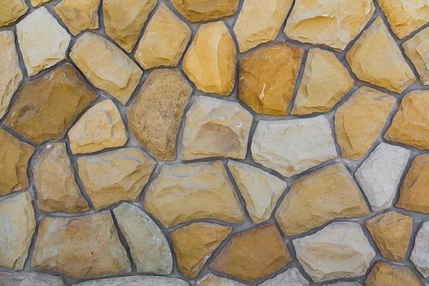 Différentes tailles de pierres de sable. mur de pierre