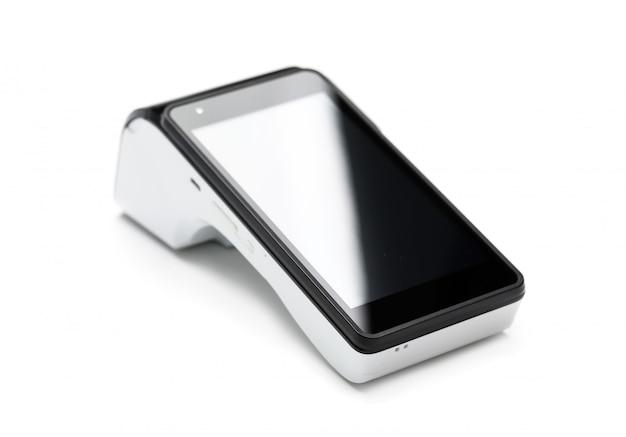 Dispositif terminal pos pour lire les cartes bancaires isolé sur mur blanc