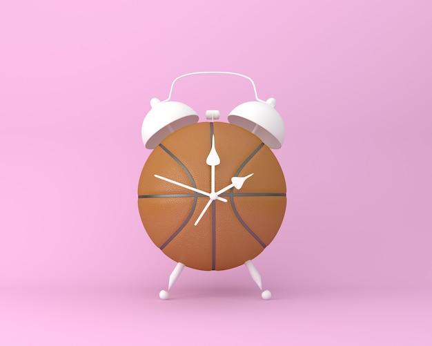 Disposition d'idée créative réveil de basket-ball sur fond rose pastel. sport idée minimale