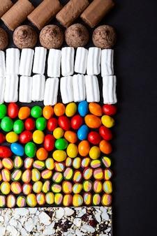 Divers bonbons colorés bonbons guimauves chocolat