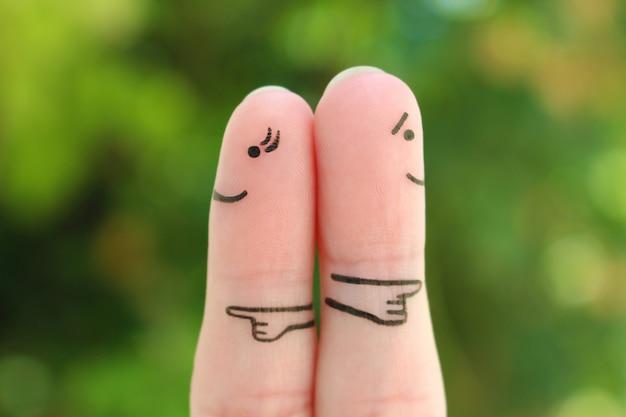 Doigts art du couple. concept d'un couple pointant dans des directions différentes.