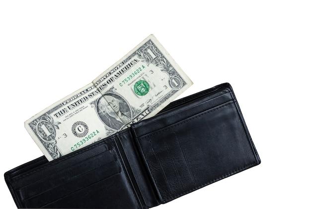 Un dollar dans un portefeuille en cuir vide isolé sur fond blanc. aucune notion d'argent. pauvreté et chômage.