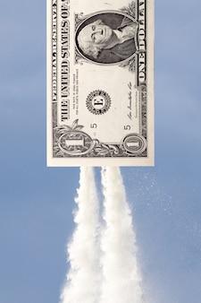 Un dollar qui vole dans le ciel. le concept de croissance monétaire