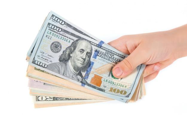 Dollars américains en main isolés