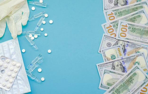 Dollars américains et pilules, ampoules contenant des médicaments, masque