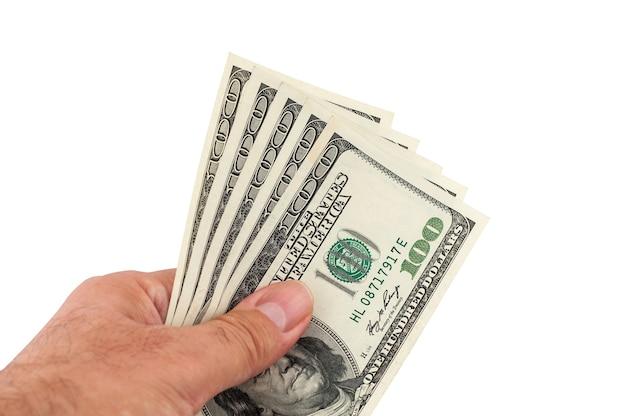 Dollars dans une main de l'homme d'affaires