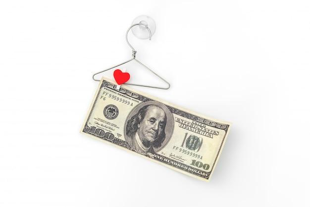 Dollars sur une pince à linge en bois.