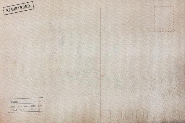 Dos de la vieille carte postale avec des taches sales