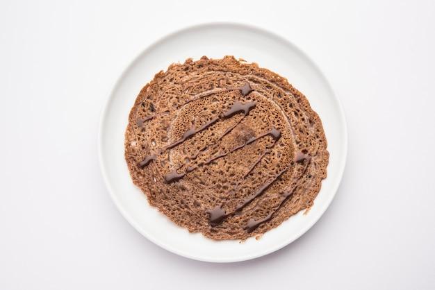 Le dosa au chocolat est une recette indienne spéciale pour les enfants, qui peut être servie au petit-déjeuner ou en collation.