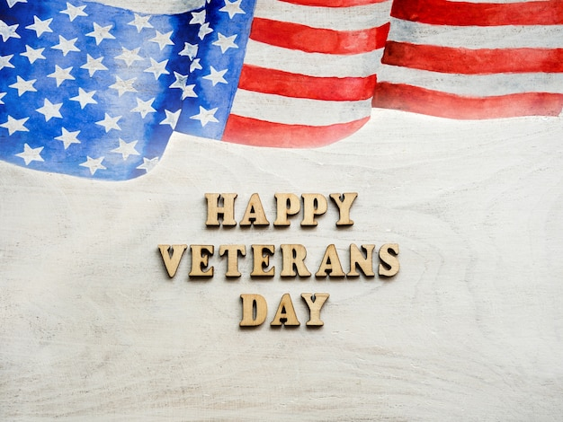 Drapeau américain à côté du texte happy veterans day