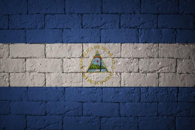 Drapeau aux proportions originales. gros plan du drapeau grunge du nicaragua