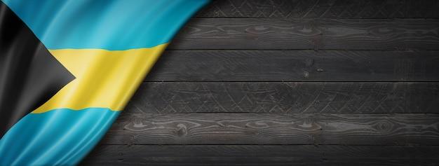 Drapeau des bahamas sur mur en bois noir
