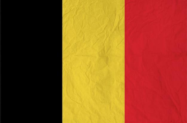 Drapeau de la belgique avec du vieux papier vintage