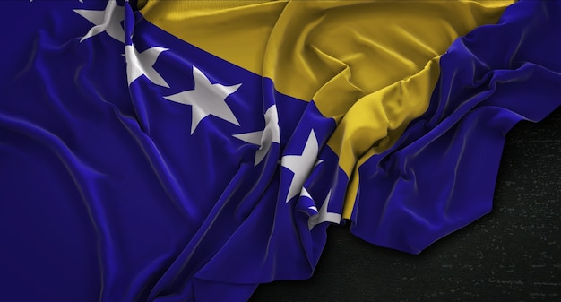 Drapeau de la bosnie-herzégovine enroulé sur fond sombre 3d rendre