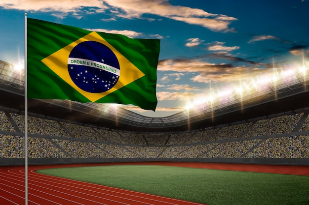 Drapeau brésilien devant un stade d'athlétisme avec des fans.