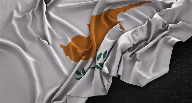 Drapeau de chypre enroulé sur fond sombre 3d render