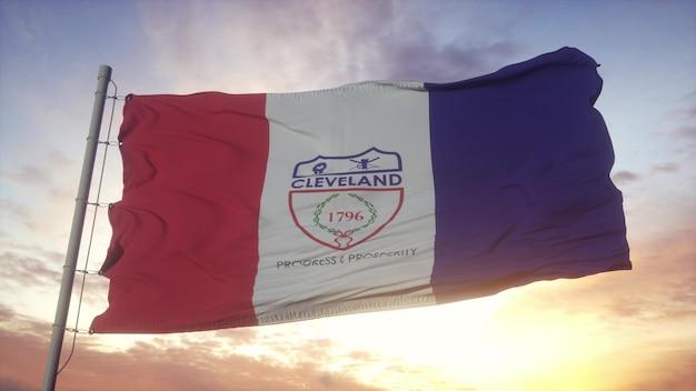 Drapeau de cleveland, ville de l'ohio, ondulant dans le vent, le ciel et le soleil. rendu 3d